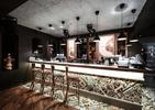 Eklektyczna architektura wnętrz restauracji The Smart Pub w mieście Krajowa w Rumunii  autor: YELLOWOFFICE
